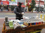 A Senegalese selling African cosmetics on the street in Jamaica neighborhood of New York City (photo by Dmitri M. Bondarenko)