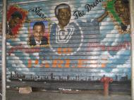 A graffiti in Harlem, New York City. The portraits (from left to right) are of Malcolm X, Barack Obama, Nelson Mandela, and Martin Luther King, Jr. (photo by Dmitri M. Bondarenko)